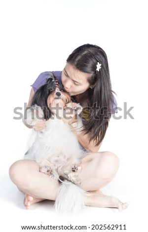 Studio shot of woman with Shih-Tzu