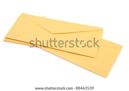 Studio shot of yellow envelopes on white background - stock photo