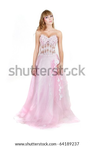 studio shot of young attractive woman in pink wedding dress over white