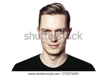 Studio shot of young handsome man with ironic smile. Isolated on white background. - stock photo