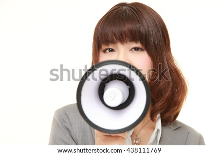 studio shot of young Japanese businesswoman wearing gray suits with megaphone