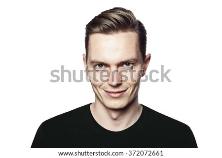 Studio shot of young man smiling to camera. Isolated on white background. Horizontal format, he is looking to the camera, he is wearing a black T-shirt.