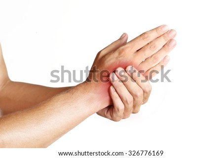 Studio shot of young man with pain in hand - stock photo