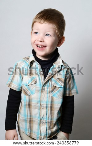 Studio shot of young, smiling boy. - stock photo