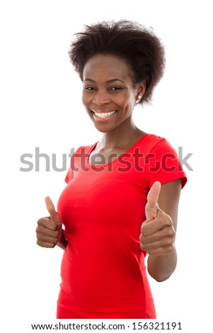 Studio shot of young woman with thumbs up - stock photo