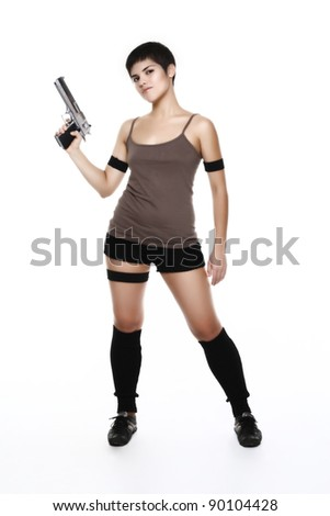 studio shot on white background: young woman holding .44 Magnum (as a Lara Croft Tomb Raider) - stock photo