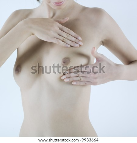 studio shot picture of a young beautiful breast naked caucasian woman doing breast palpation - stock photo