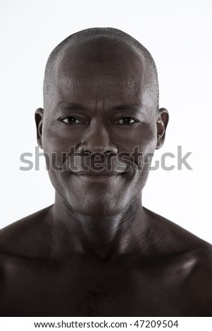 studio shot portrait of a bare smiling forty Handsome Afro-American Man - stock photo