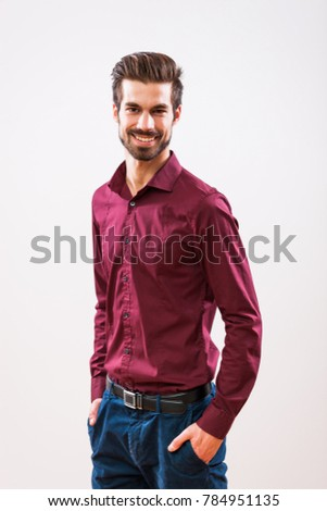 Studio shot portrait of young successful man.