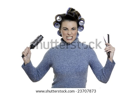 studio shot portraits of a young funny and cute woman on a white background annoyed and raging to be a hair-curlers victim - stock photo