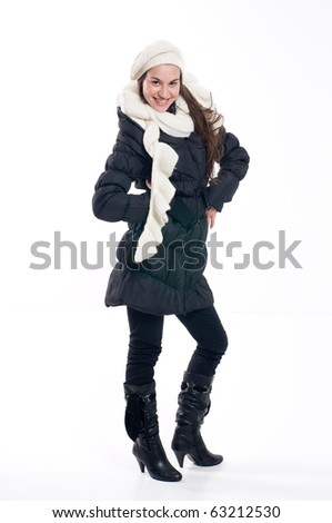 Studio shot young happy woman in winter clothes - stock photo