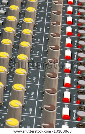 studio soundboard dials and led lights - stock photo