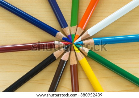studio still life abstract of art pencils in circle or radial pattern - stock photo