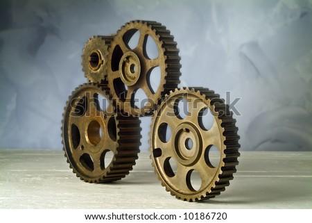 studio still life of four cog-wheels - stock photo