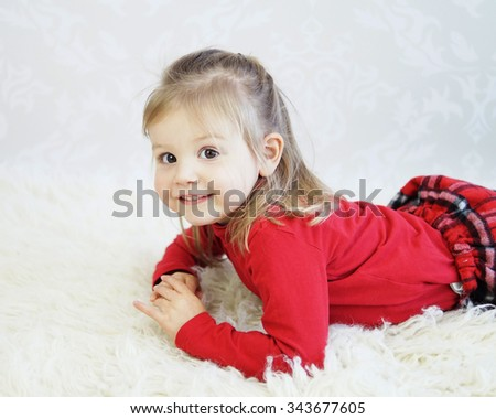 Studio style photo of young girl smiling and showing emotion - stock photo