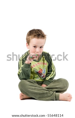 Studiopicture of a child who is going to brush his teeth, isolated on white. - stock photo