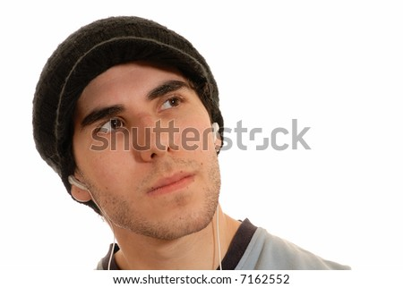 studious young man listening to mp3 player through white earphones, isolated on white