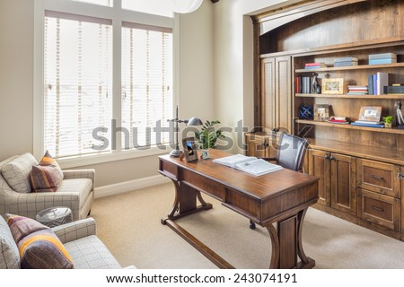 Study and Home Office in Beautiful New Luxury Home - stock photo