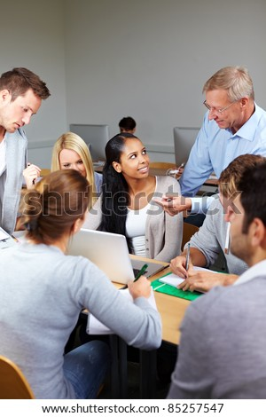 Study course with teacher and students in university - stock photo