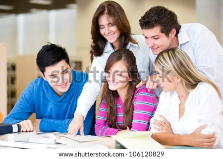 Study group at the library with the teacher - stock photo