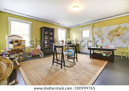Study play family room with kids toys with large map. - stock photo
