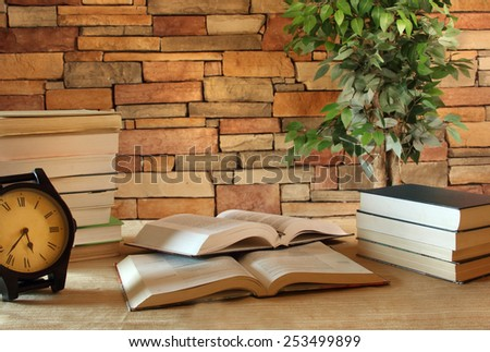 Study table with books in an office room - stock photo