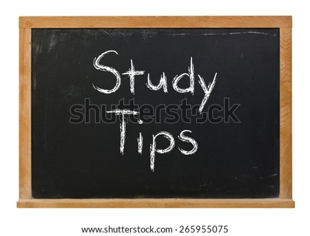 Study tips written in white chalk on a black chalkboard isolated on white - stock photo