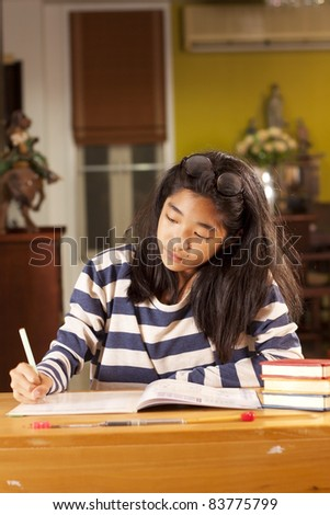studying, a girl writing on a lesson book, study.