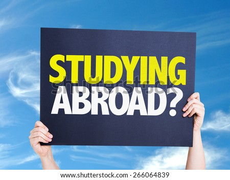 Studying Abroad? card with sky background - stock photo