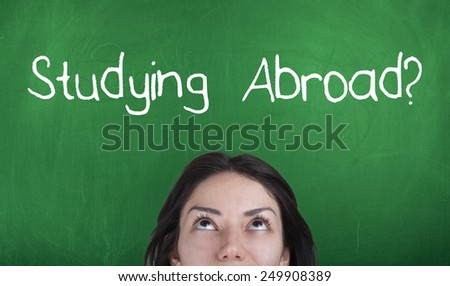 Studying Abroad Concept / Student Thinking About Studying Abroad - stock photo