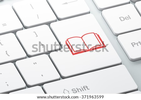Studying concept: Book on computer keyboard background - stock photo