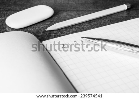 Studying in the school, solving mathematical problems, a pencil  - stock photo
