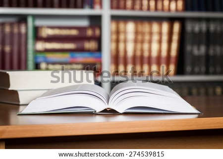 Studying. Library with stack of books opened. - stock photo