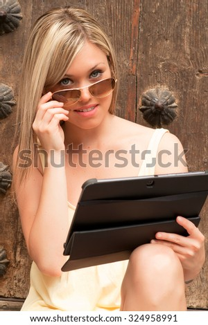 studying teenager with a tablet computer