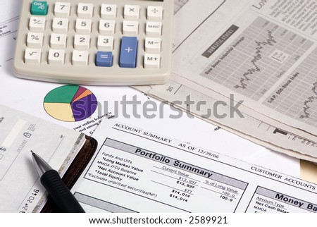 Studying the stock reports to figure out where to put your retirement money. - stock photo