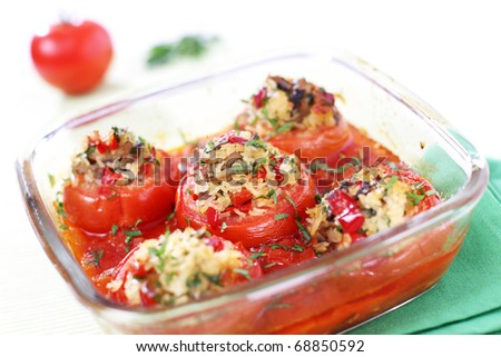 Stuffed and baked tomatoes with rice and mushrooms - stock photo
