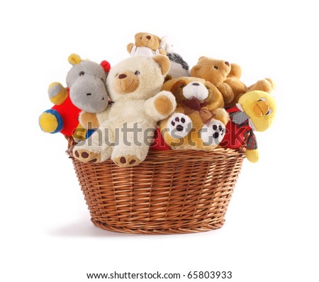 Stuffed animal toys in a basket isolated on a white background - stock photo