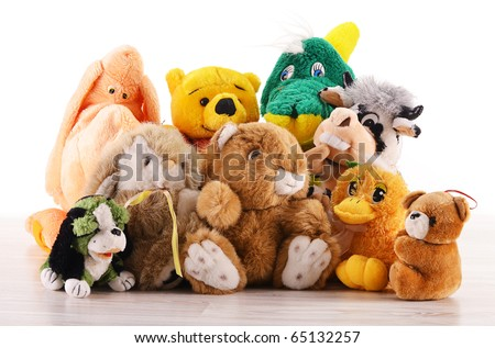 Stuffed animal toys on the wooden floor isolated on white - stock photo