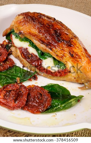 Stuffed breast baked with dried tomatoes, mozzarella, spinach