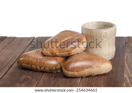 Stuffed Buns on wooden background, isolated - stock photo