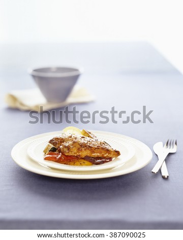 Stuffed Chicken breast served on plate with cutlery on table - stock photo
