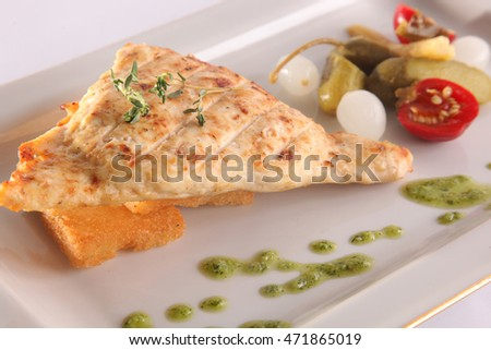stuffed chicken breast with vegetables on plate