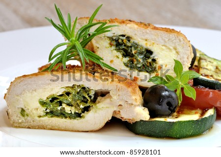 Stuffed chicken fillet with vegetables - stock photo