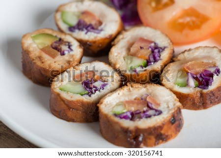Stuffed chicken rolls with vegetable on white plate. Selective focus. - stock photo