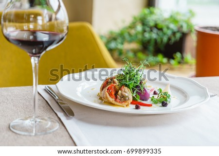 stuffed chicken with roasted vegetables and red wine