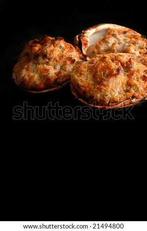 stuffed clams - isolated on black - stock photo