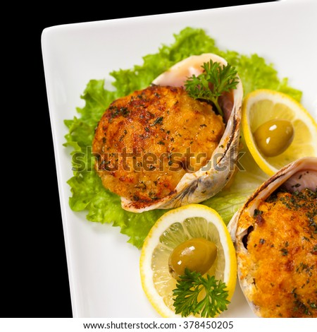 Stuffed Clams Isolated on black background. Selective focus. - stock photo