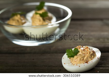 Stuffed eggs with chicken pate, red pepper and chilli - stock photo