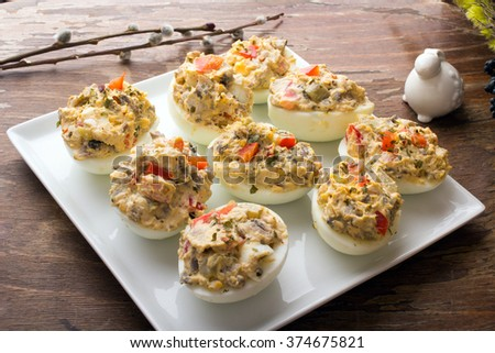 stuffed eggs with peppers, mushrooms and herbs - selective focus - stock photo