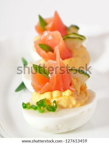 stuffed eggs with salmon - stock photo